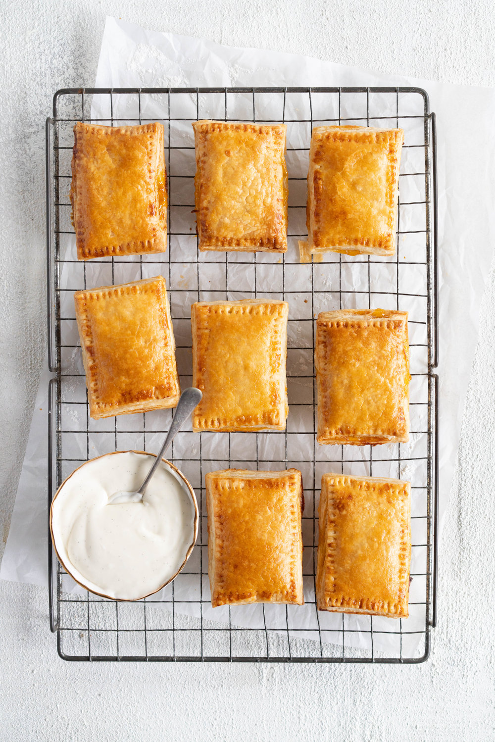 Apricot Pop Tarts with Vanilla Bean Icing - a quick apricot jam is enclosed in a buttery, flaky puff pastry, before being finished off with a vanilla bean icing. #poptart #pastry #apricot #jam #apricotjam #vanillabean
