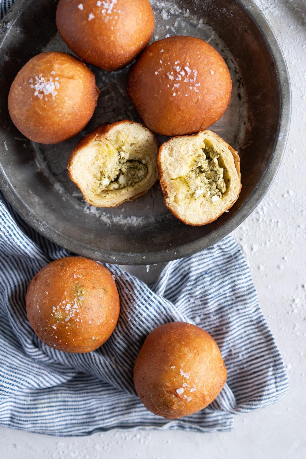 Basil Pesto and Feta Stuffed Savoury Brioche Doughnuts - Brioche dough is wrapped around a basil pesto and feta filling, then fried to golden brown perfection #savoury #savory #briochedoughnut #pestoandfeta #donut #brioche
