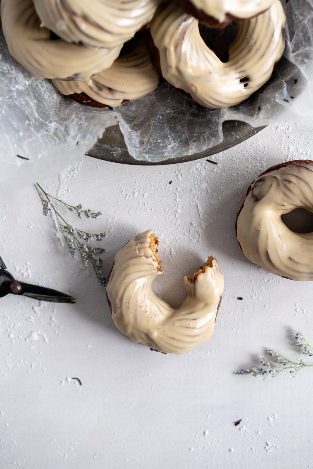 Earl Grey Crullers with Earl Grey Glaze. Perfectly flaky earl grey infused choux pastry is fried into golden brown crullers, then glazed with a delicately flavoured Earl Grey Glaze. #earlgrey #cruller #doughnuts #donuts #baking #fried #choux #chouxpastry