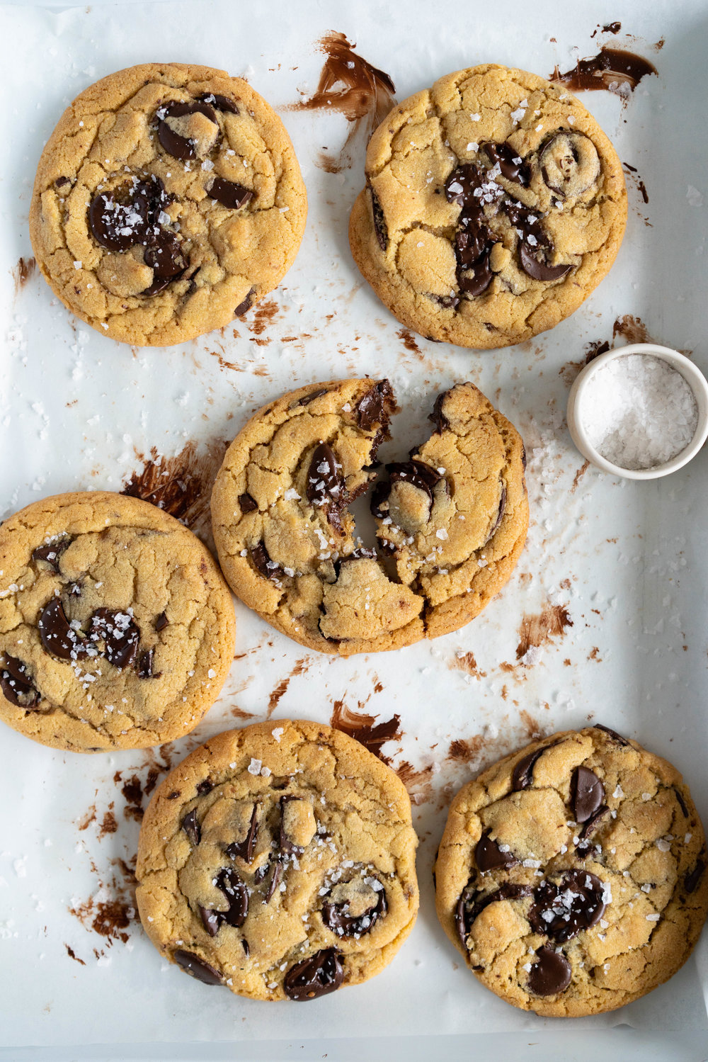 Olive Oil Chocolate Chip Cookies from The Cookie Book by Rebecca Firth. Huge, chewy chocolate chip cookies, with a unique fruitiness from the olive oil. These are a perfect twist on the classic chocolate chip cookie #chocolatechipcookie #oliveoilcookie #easycookierecipe