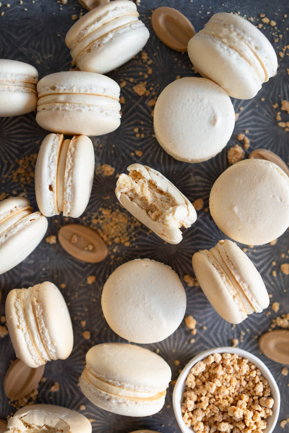 Toasted Sugar Vanilla Bean Macaron shells are sandwiched with a silky, creamy German buttercream loaded with caramelised white chocolate, Subtle elevated flavours makes this a perfect simple recipe that is sure to wow your friends or make the perfect treat or gift. #frenchmacaron #macaronrecipe