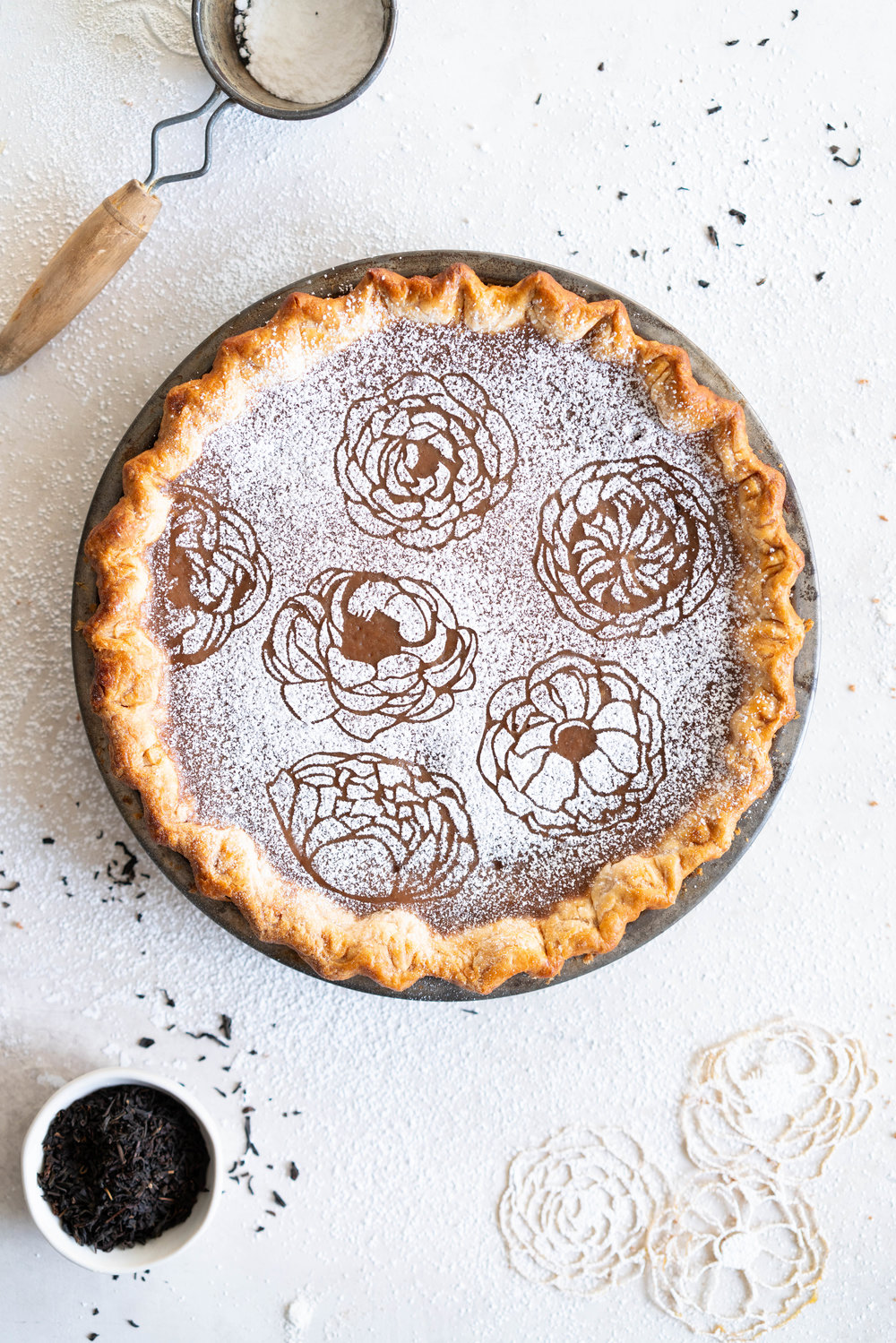 Earl Grey Sugar Pie - Fragrant Earl grey custard is spiked with vanilla bean, and finished with a hefty dusting of powdered sugar. An egg free version of a custard favourite that bakes perfectly flat and will never crack on you.