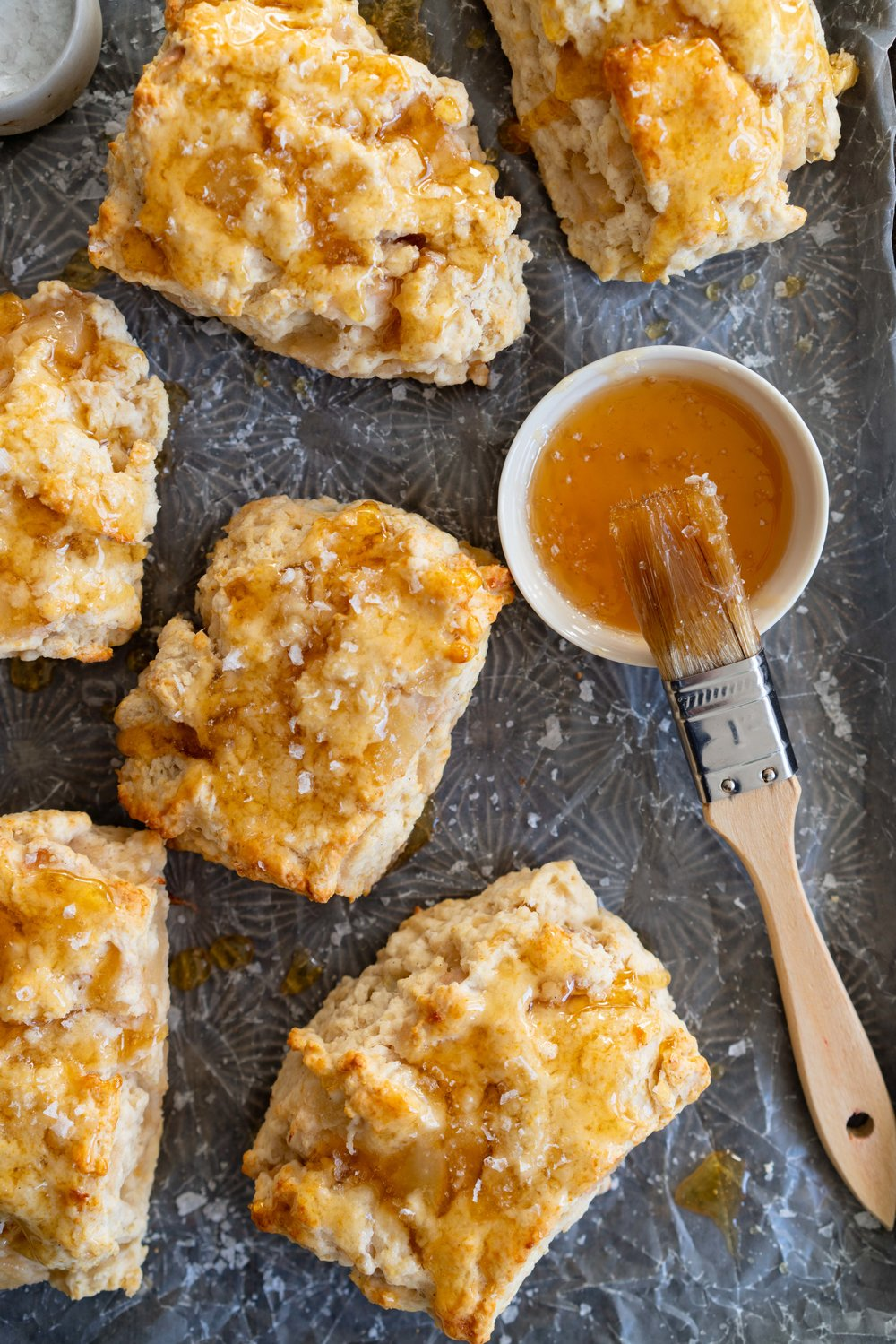Roasted Pear and Vanilla Bean Scones with Salty Honey Glaze - Giant Craggy Scones filled with pear chunks held together with tender scone dough, and finished with a sticky honey glaze and a generous dose of flaky sea salt.