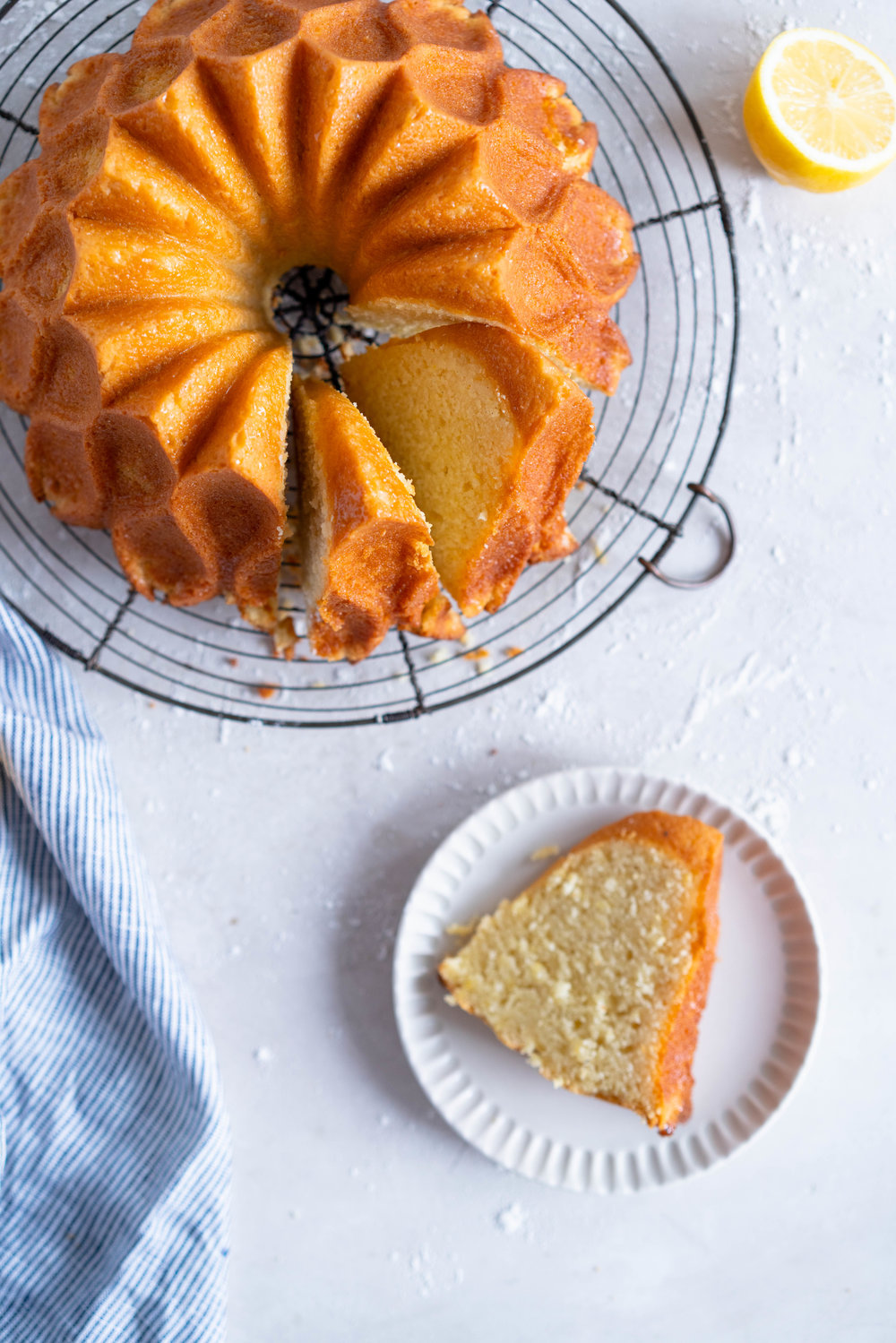 Olive Oil, Lemon, and Yoghurt Bundt Cake - a simple cake which comes together in two bowls, no fancy equipment required. Perfectly dense, flavoured with tangy greek yoghurt and floral, fruity olive oil. the perfect cake for any occasion. #bundtcake #lemonbundt
