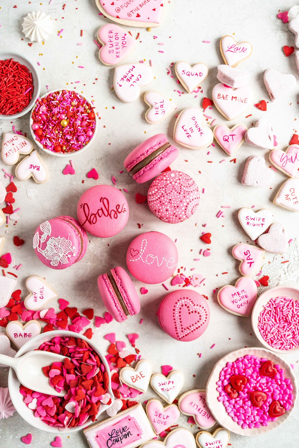 The Ultimate Valentine's Day treat box - a perfect mix of cookies and sweet treats to help celebrate valentine's day or the ones you love. This would make the most amazing gift - we included macarons, painted sugar cookies, linzer cookies, chocolate sandwich cookies, meringue kisses, soft earl grey caramels, and marshmallow hearts. #valentinesday #cookiebox