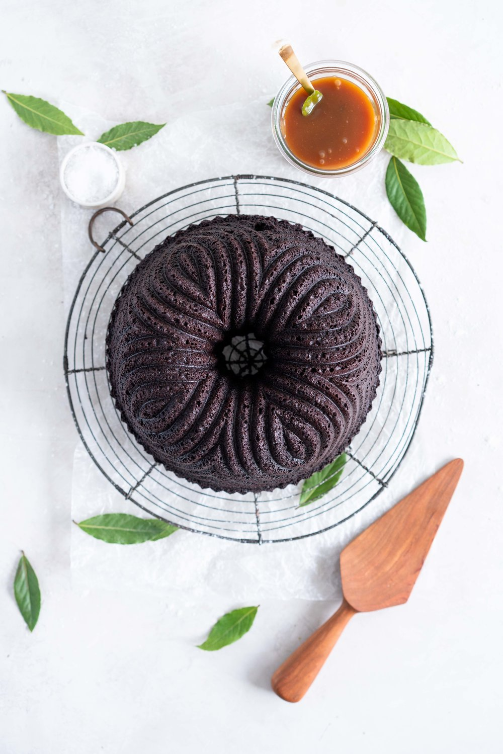 One Bowl Devil's food bundt cake with bay leaf caramel - a dense, moist chocolate bundt cake is loaded up with a lightly infused bay caramel. The cake is amazing alone, but with the caramel it is the perfect match. #devilsfoodcake #chocolatebundtcake #baycaramel