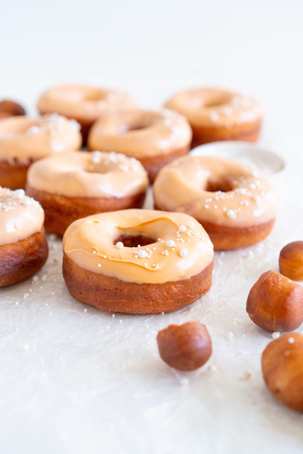 Orange Brioche Doughnuts with Orange CBD glaze. Orange infused yeast raised brioche doughnuts are topped with a sweet glaze, enhanced with CBD oil. #doughnuts #cbd