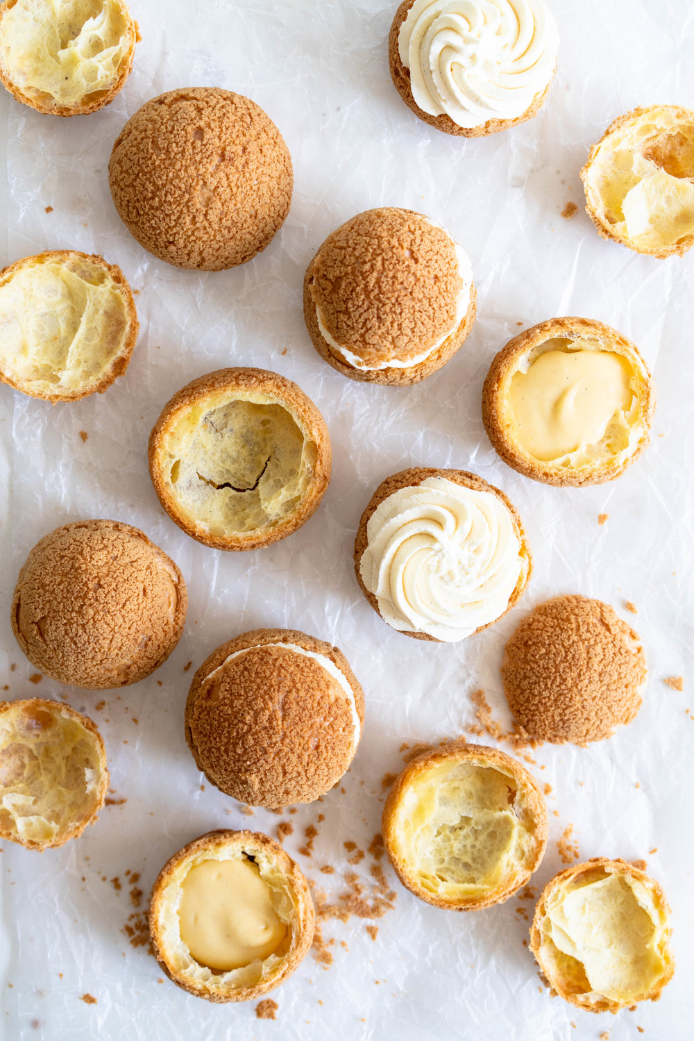 Choux au Craquelin - Cream Puffs with Passionfruit Cream and Passionfruit Whipped Cream. Crispy, light cream puffs, topped with crunchy craquelin, are filled with a tart passionfruit cream, then topped with a smooth passionfruit whipped cream. The perfect dessert for if you are feeling a little fancy! #creampuffs #passionfruit