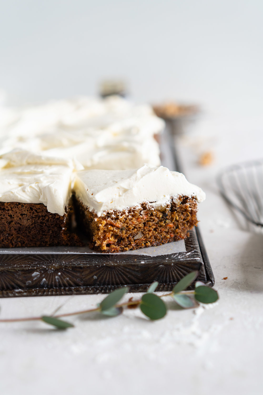 Brown Butter Carrot Sheet Cake is taken to the next level with a fluffy, whipped vanilla bean cream cheese german buttercream. This cake comes together super easily but is super delicious, and would make the perfect easter dessert. #brownbutter #carrotcake #sheetcake #germanbuttercream