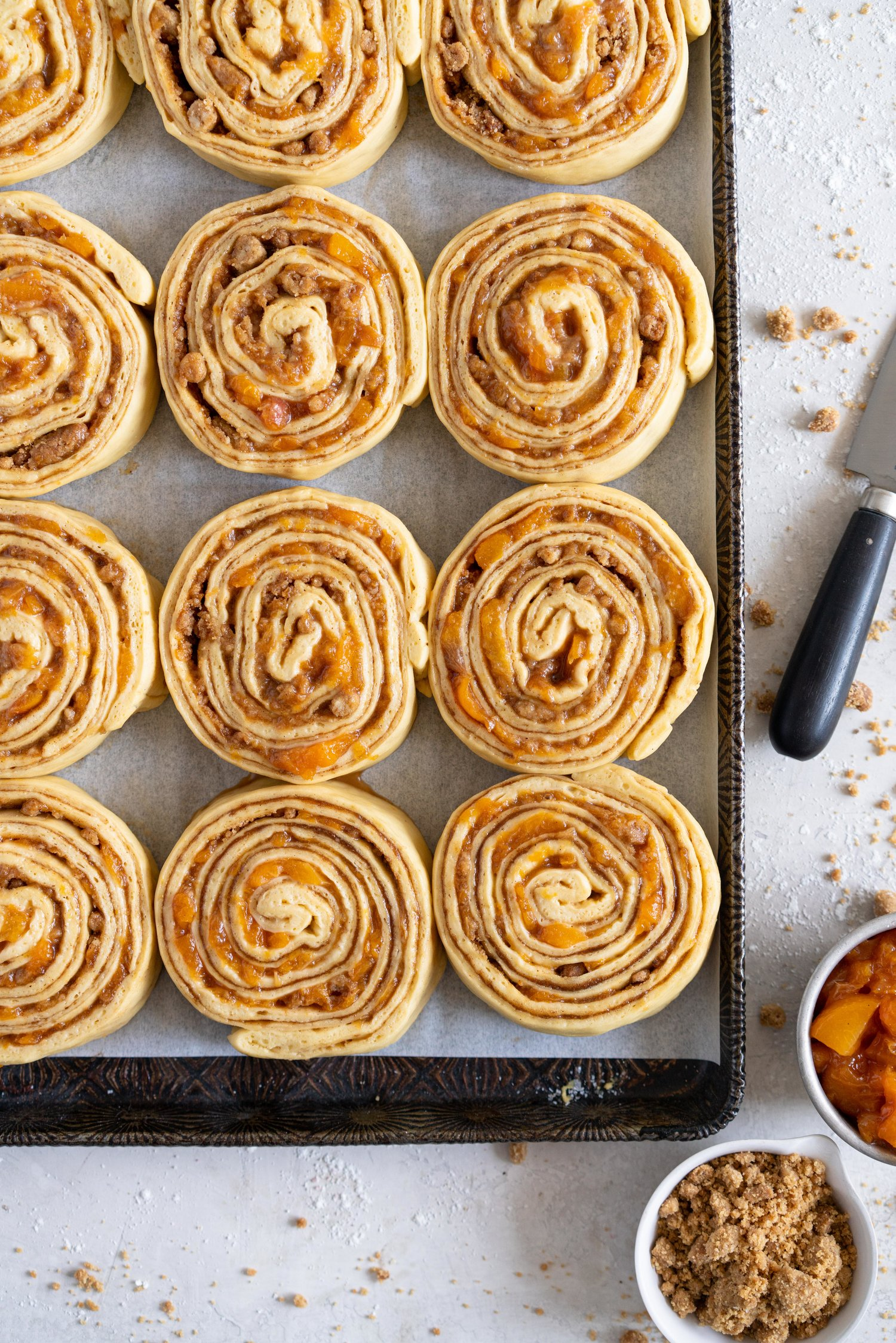 Laminated Brioche Cinnamon Buns with Peach Compote and Brown Butter Streusel