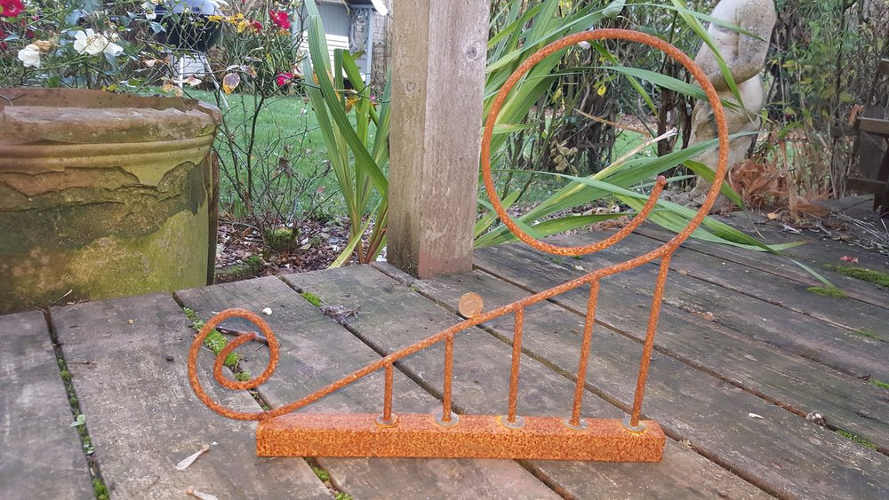 An experiment in bending steel rods and rusting steel without sandblasting first
