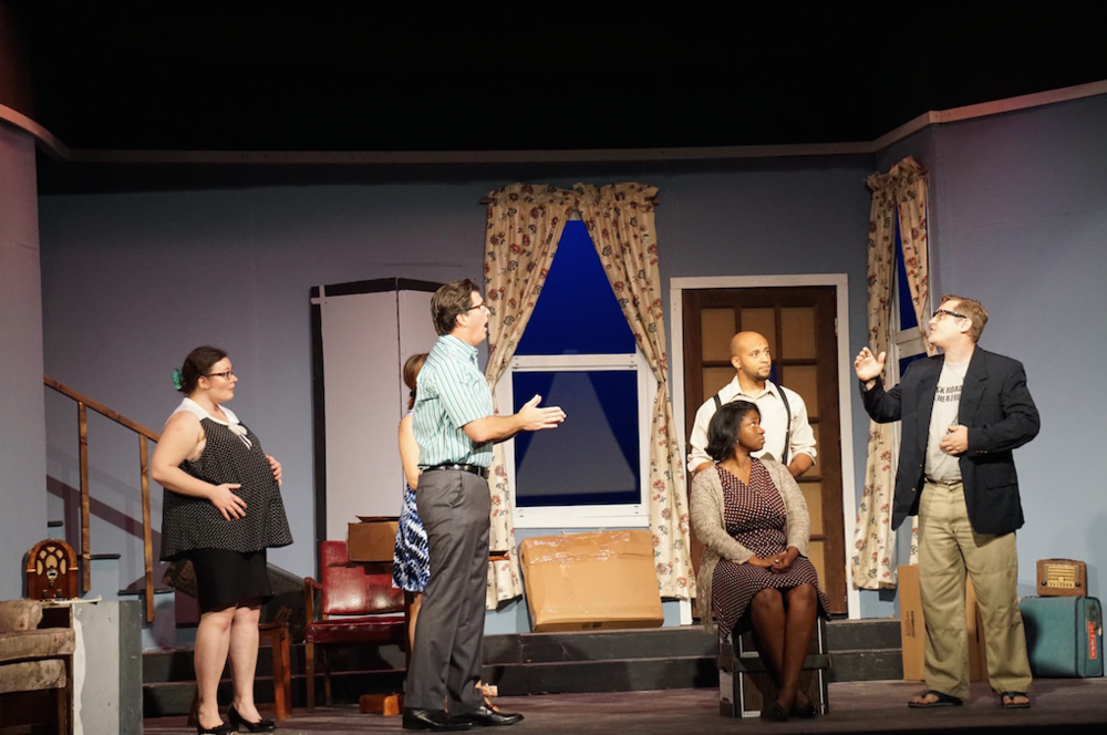 "Actors performing a scene in the first act of the play ""Clybourne Park"", which is now on at the Dundas. Images by Kelsey Nottage."