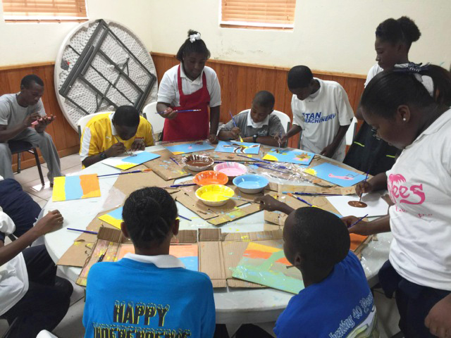 Eleutheran School children engaging in 'Paint Like Amos' workshop in parish hall.
