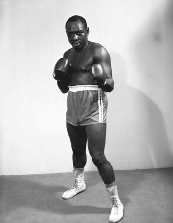 "Bahamian boxer Leonard ""Boston Blackie"" Miller photographed by Antoine Ferrier. (NAGB's ""Developing Blackness: Studio Photographs of 'Over the Hill' Nassau in the Independence Era"")"