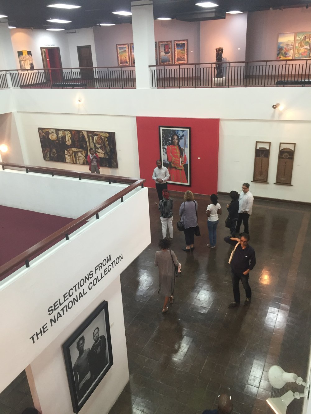Interior view with tour group at National Art Gallery of Jamaica.