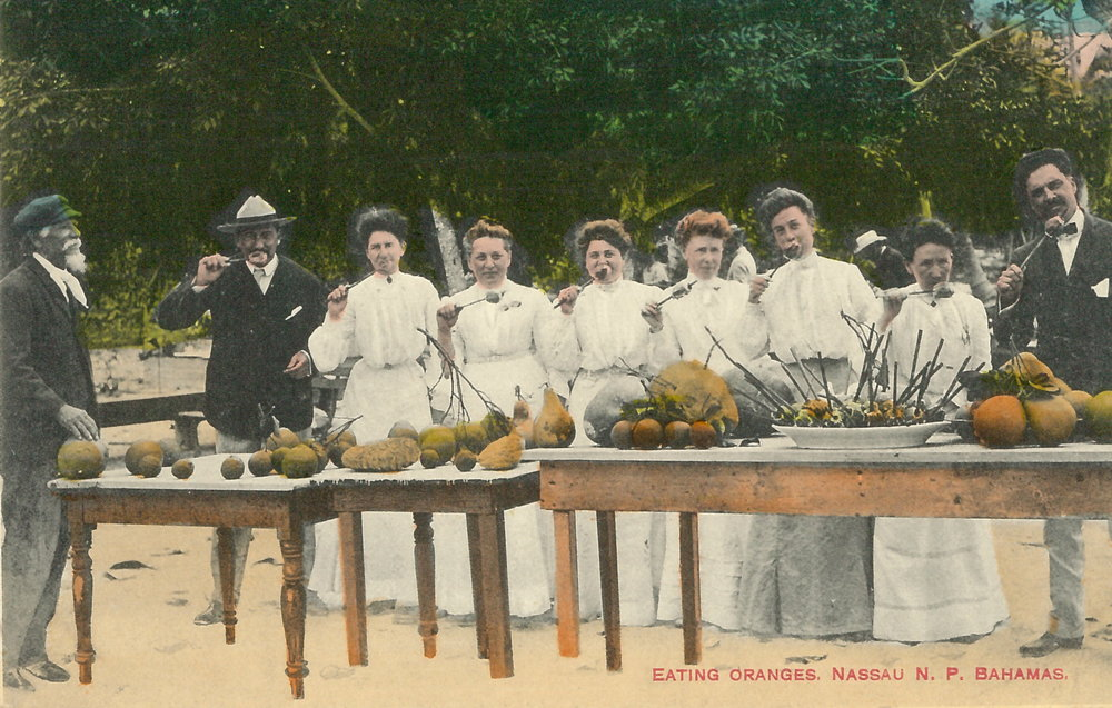 "James ""Doc"" Sands, 'Eating Oranges' (estimated c.1890-1930), hand painted postcard. ""Visitors line up to sample exotic fruit"". Images courtesy of the NAGB. Donated by Stephen Lash."