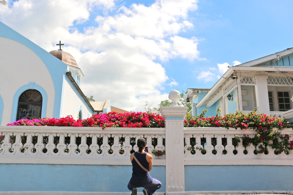 Participant Anne Ulentin during the Picture Nassau photowalk taking a photo of the Greek Orthodox Church.