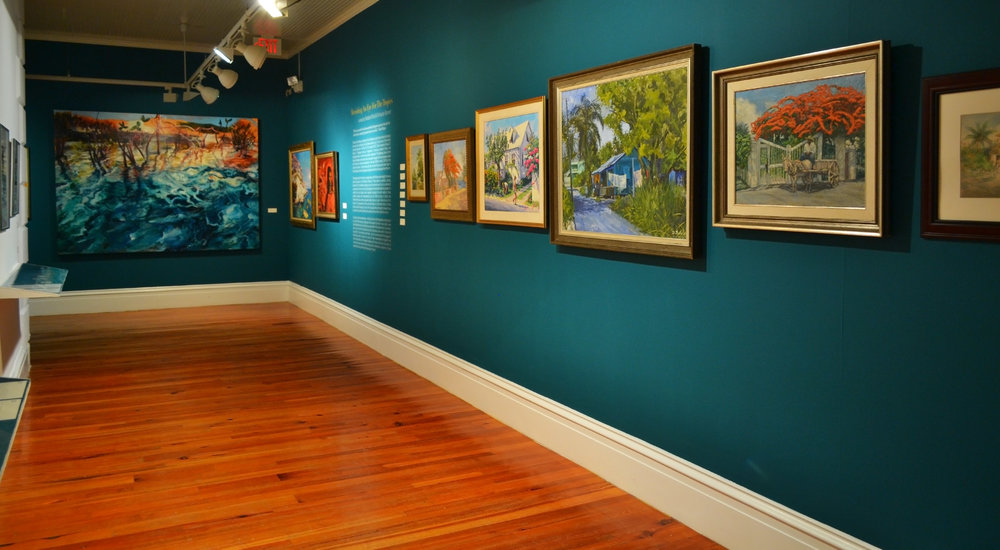 "1.     Installation shot of Dorman Stubbs' ""Bain Town"" (1984) as seen in the current Permanent Exhibition, ""Revisiting An Eye For The Tropics"" at The National Art Gallery of The Bahamas"