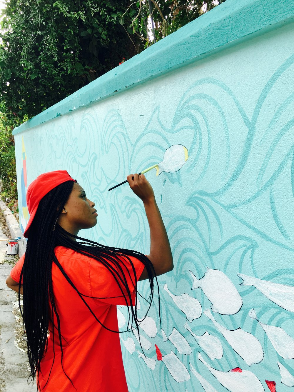 Shardae Pratt working alongside Dede Brown and Dylan Rapillard for the 'World Oceans Day 2017' mural on West Hill Street.