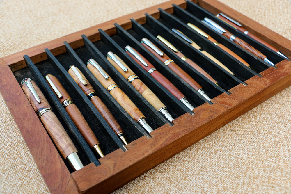 Collection of pens made from a variety of wood types by Robin Hardy, 2017 (Photo by Keisha Oliver)