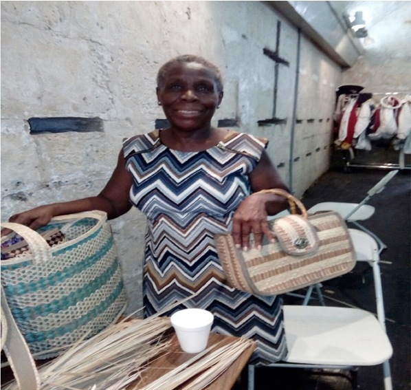 Creative Nassau Market Artisan Judy Mae Rolle, showcasing her straw work pieces