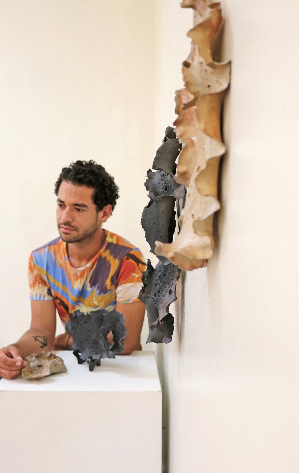 Bahamian ceramicist Alistair D. Stevenson with 'All of My Emotions'. Doongalik Studios, Nassau, Bahamas