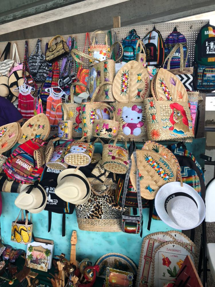 Straw bags and fans with floral and Disney Princesses motifs at the ferry pier on Paradise Island.  Image courtesy of Marina Reyes Franco.