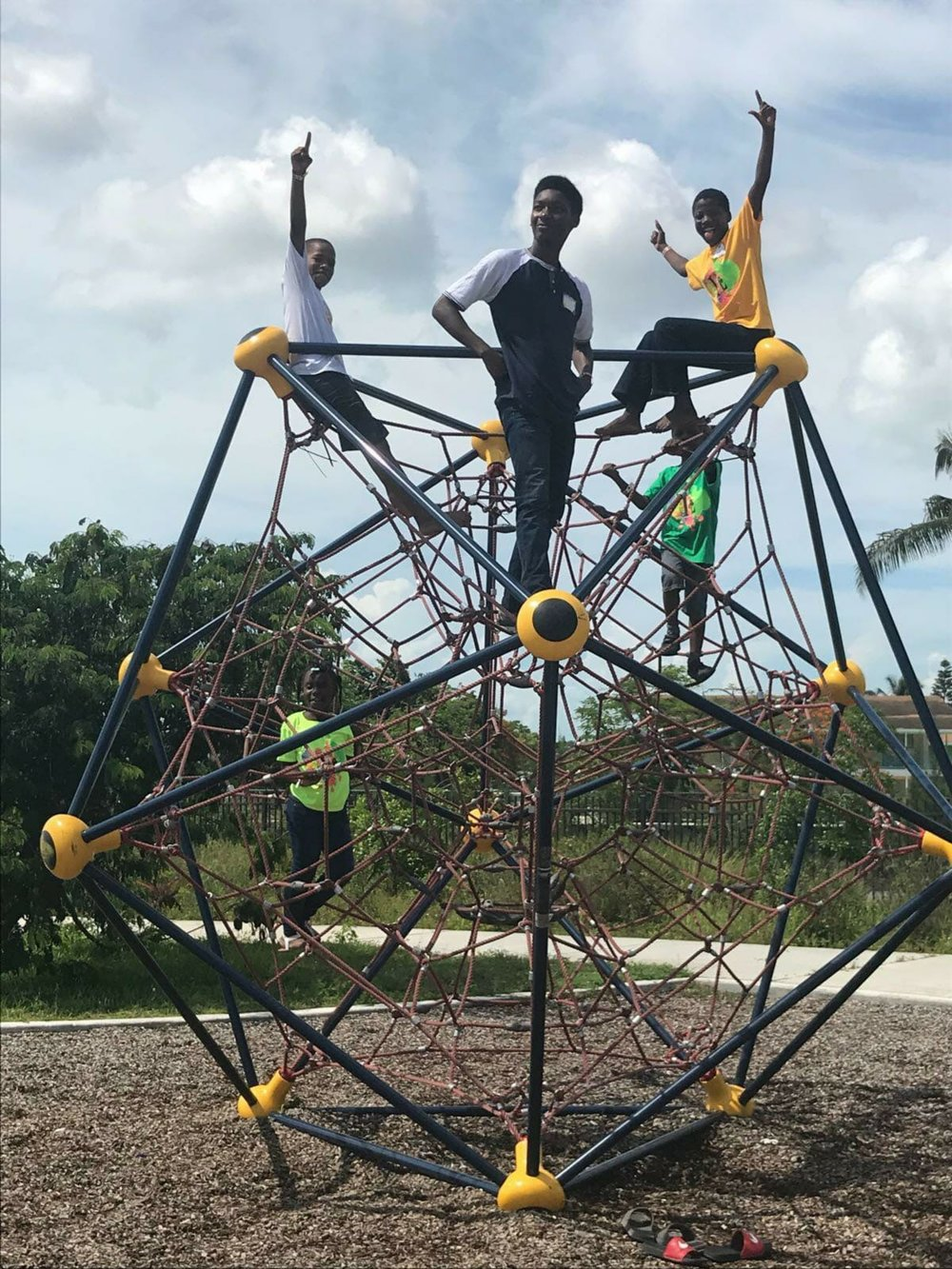 Students of Camp Lit: Big Pond gather for play time during lunch session on the jungle gym.