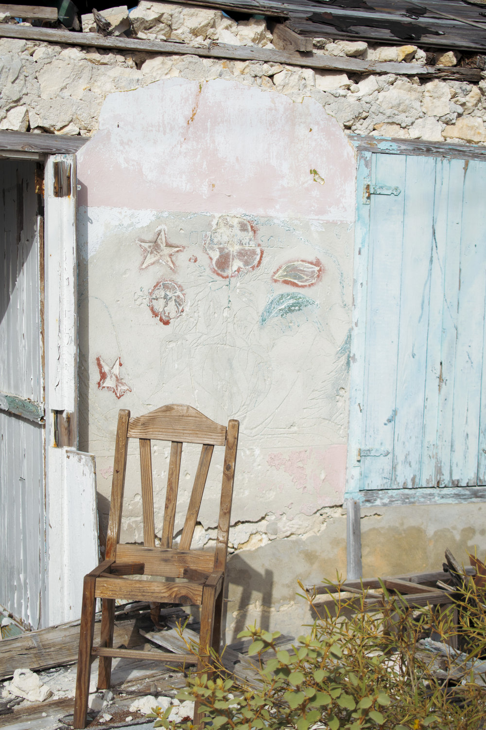 A lonely chair rests outside a house on Ragged Island. Photo by Ethan Knowles.