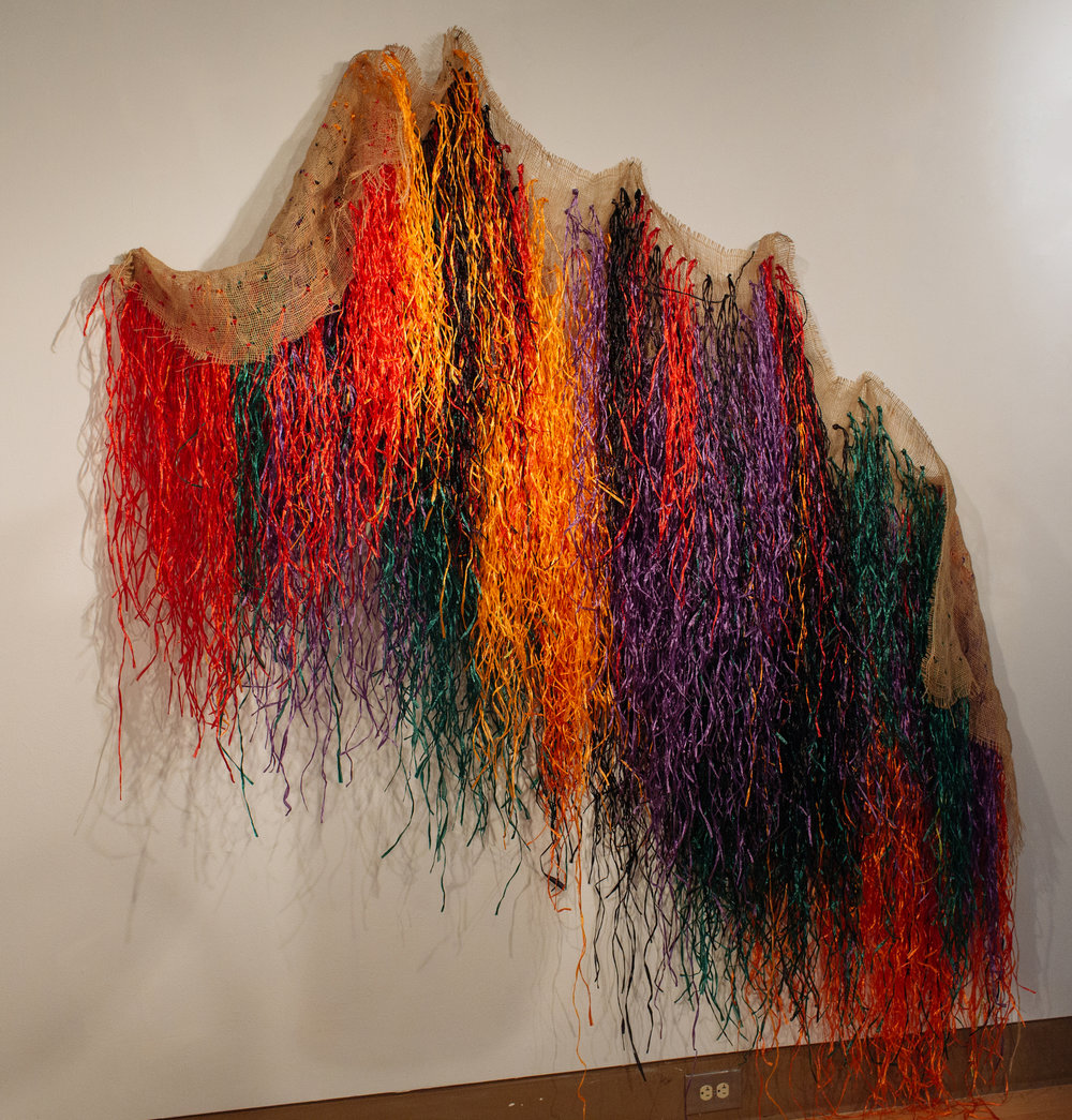 Elevating the Blue Light Special , (2018). Averia Wright. Mixed Media Installation.  Bronze, Burlap, Raffia, & Various Textiles. Dimensions variable.