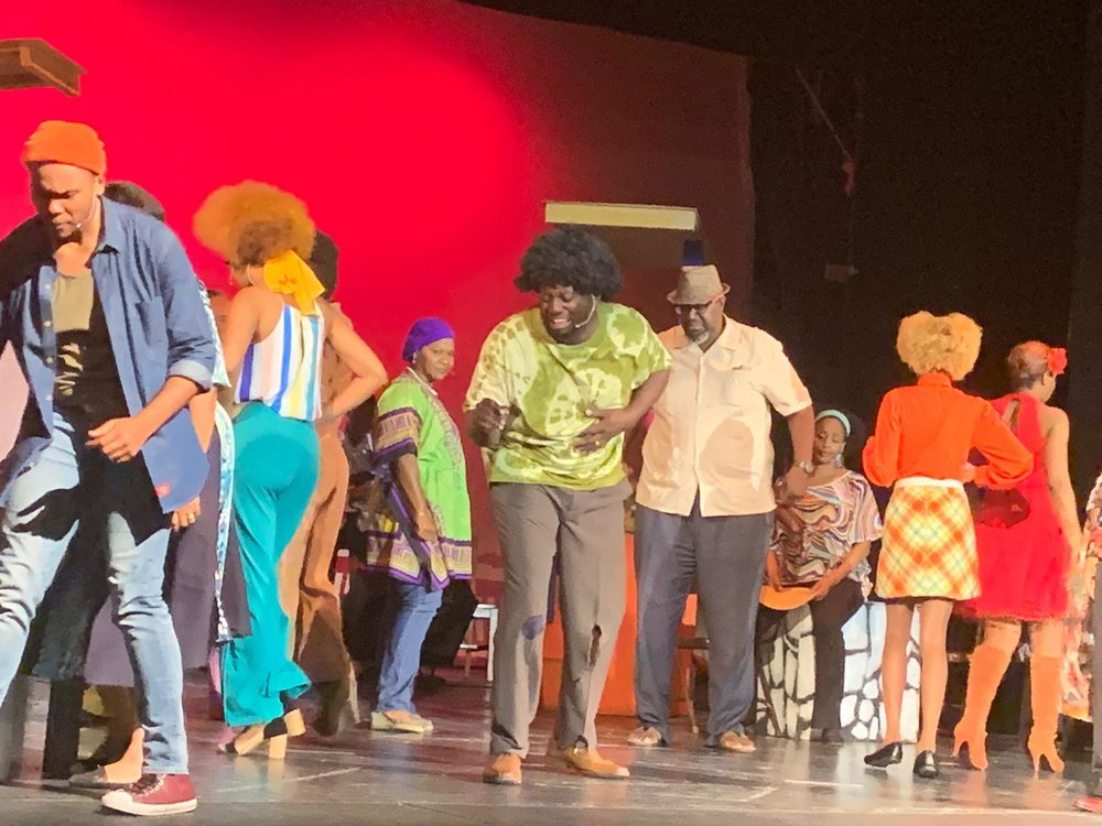 Cast      from  Der Real Ting,  L-R Samantha      Pratt, Osano Neely (Johnny), Fabienne Bailey-Brown, Anja Bowe, Gregory      Deane, Ali Culmer, Sasha Major, Rose Barrett, and members of the band led      by Fred Ferguson.  Image courtesy of      Nicolette Bethel.