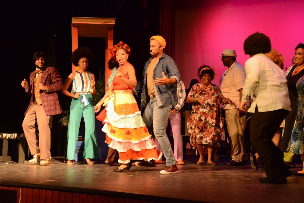 Image      from the 2018 Shakespeare in Paradise Season. L-R Ezzra Thompson (Gregory      Dean), The Magistrate (Tex Turnquest),        Miss Bessie (Contanza Adderley), the brothers' father Amos Williams      (Qunicy Parker) politicians Clinton Roberts (Rossano Deal) and Joshua      Hanna (Alfred A. Culmer). Images by Peter Ramsay