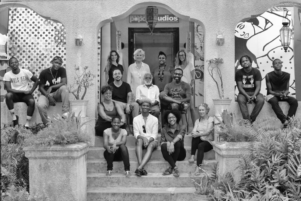 UB student artists and Popop Studios art team captured at front steps of studio space. Image courtesy of Popop Studios.