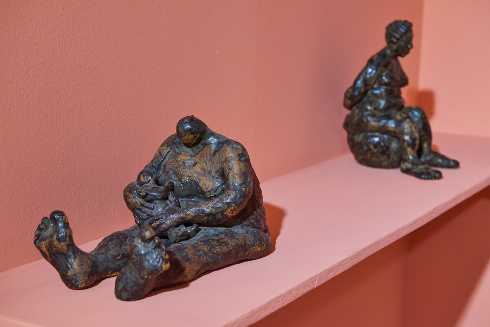"""Installation view of Joann Behagg's series of earthenware figures of women as seen in the NAGB's Permanent Exhibition """"Hard Mouth: From the Tongue of the Ocean""""."""