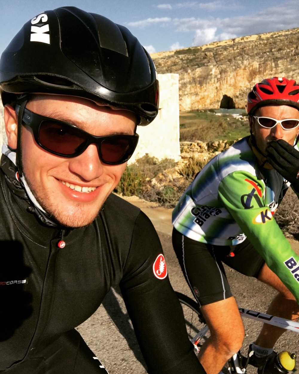 Cycling up Dwejra with Domenic (right)