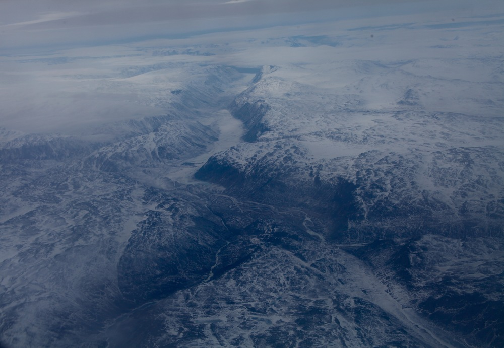 Western Greenland's cracked and icy landscape from the air (Photo by Andrew Evans)