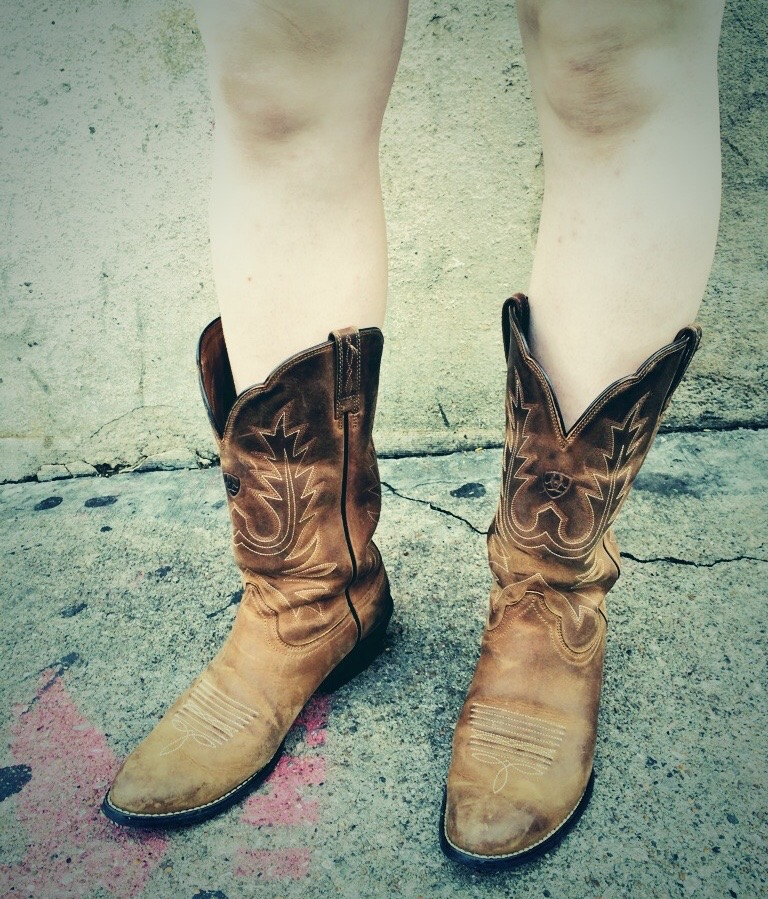 Country music cred in the form of well-worn cowboy boots on the streets of Nashville. (Photo by Andrew Evans)
