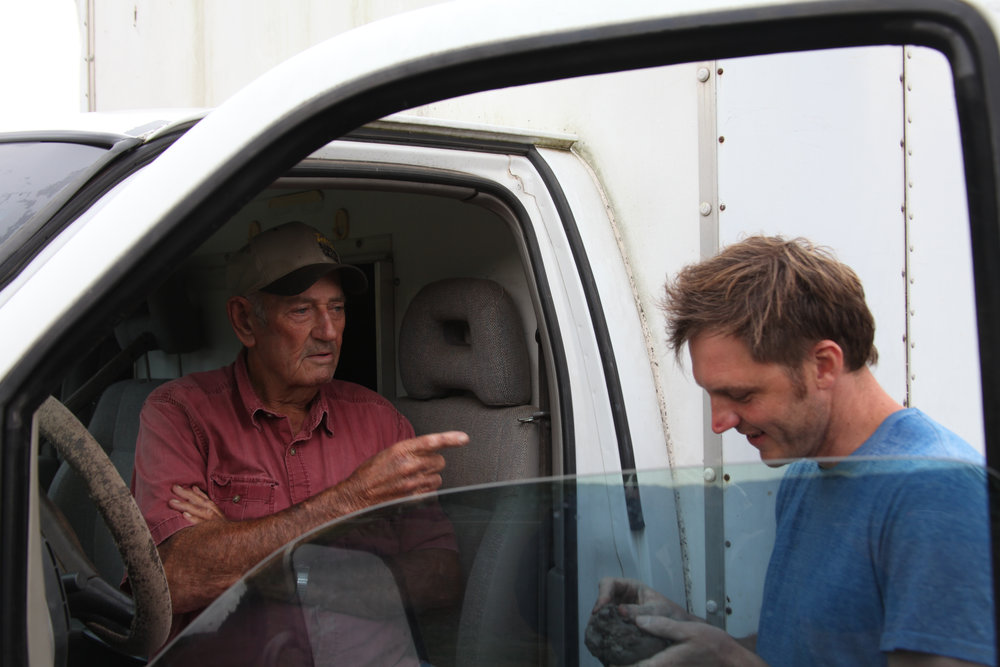 North Carolina farmer Neal Woody chats with artist Josh Copus. (Photo by Andrew Evans)