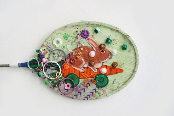 I started painting with gouache on fabric stretch over random objects like this badminton racket.