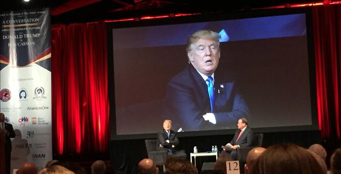 DONALD TRUMP, with Gov. Mike Huckabee serving as moderator for the historic