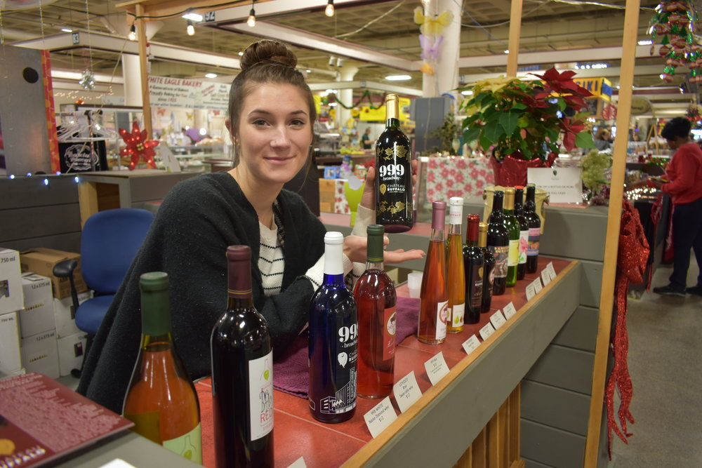 Kristen Lemke is learning the wine-making process from Carl — she was already pretty good at selling at the Market thanks to her Mom's years of experience there.