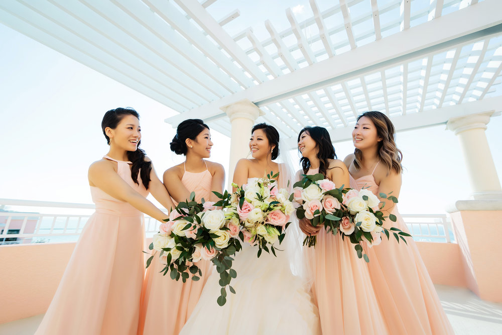 hyatt regency clearwater beach, bridesmaids, roses, peach, wedding photography, rooftop, beach, limelight photography