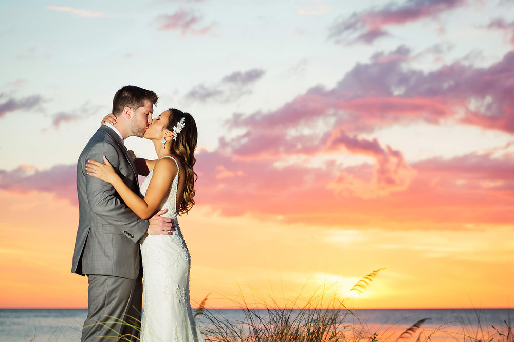 hyatt clearwater beach, sunset, romance, kiss, ocean, beach, wedding photography, limelight photography