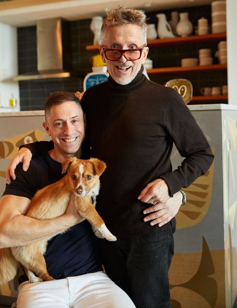 Jonathan and his partner, Simon Doonan, and their dog FoxyLady.