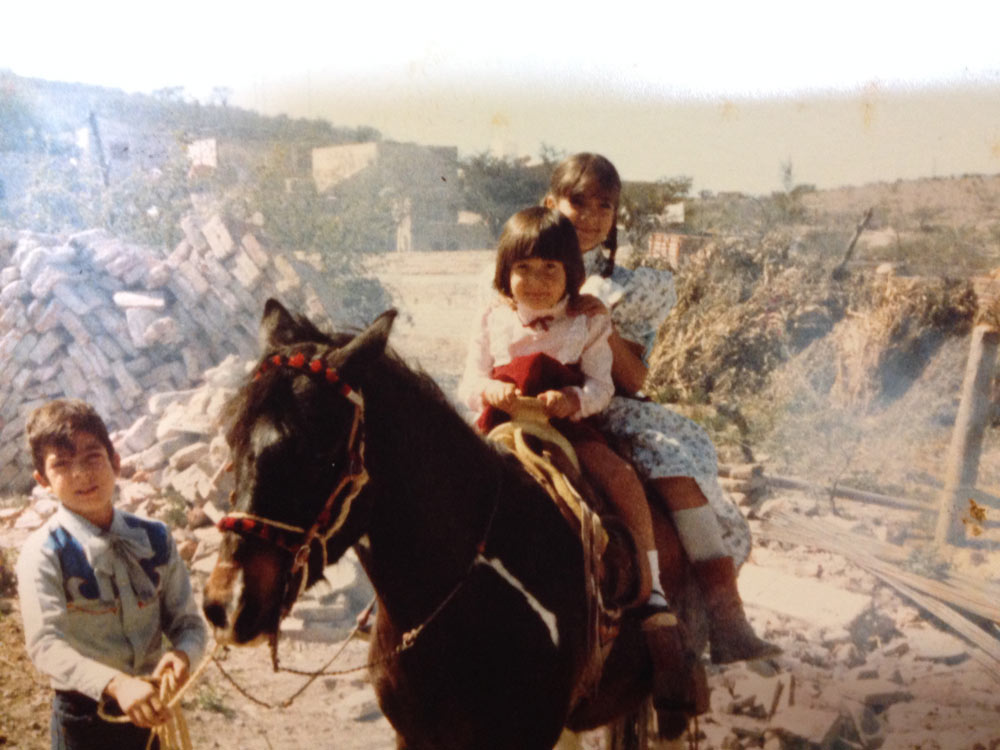 A young Tanya riding a horse.