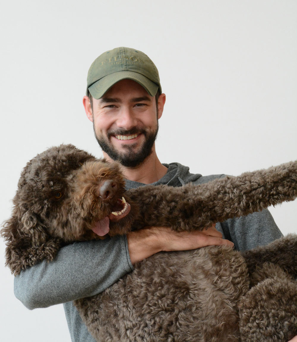 Seth Grizzle with his dog, Fig
