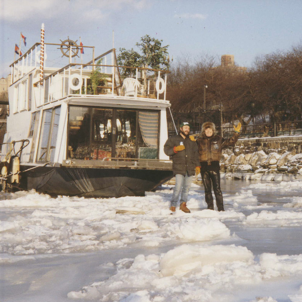 Jan & friend/colleague Doug Hynes standing on a frozen Hudson River, when it used to freeze solid. (1988)