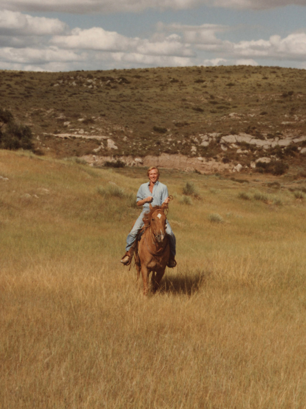 A young Jerry Helling riding a horse - growing up on a ranch in Colorado