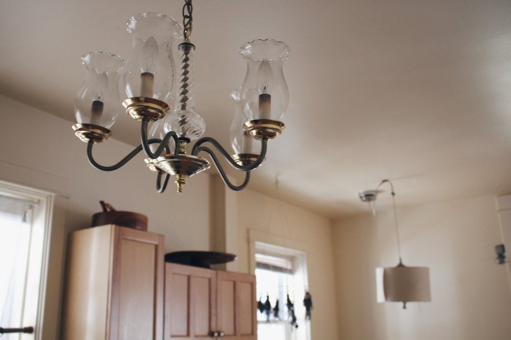 This old chandelier screamed Farmhouse, and the one in the back just had a bulb, so i covered it with an old lampshade.