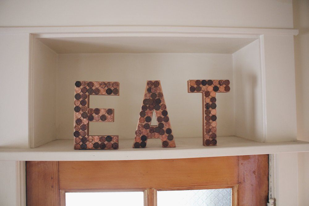 DIY: penny EAT sign. All you need is some cardboard letters and copper paint from the craft store.. and about $2 in pennies.